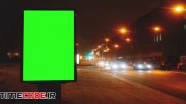 دانلود استوک فوتیج : بیلبورد با پرده سبز در خیابان A Billboard With A Green Screen On A Streets