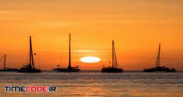 دانلود عکس استوک : ضد نور قایق در غروب خورشید Boat Sunset