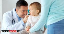 دانلود عکس استوک : پزشک در حال معاینه نوزاد Doctor With Otoscope Checking Baby Ear At Clinic