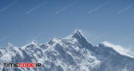 دانلود عکس استوک : کوه برفی Mountain Peak Against A Blue Sky