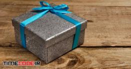 دانلود عکس جعبه کادو با روبان آبی Gift Box With Blue Ribbon