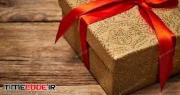 دانلود عکس جعبه کادو با روبان قرمز  Gift Box With Red Ribbon