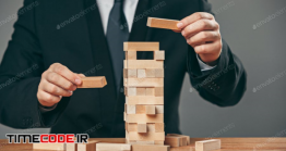 دانلود عکس با مفهوم مدیریت Man And Wooden Cubes On Table