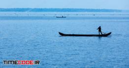 دانلود عکس ضد نور مرد با قایق در دریا  Man On Boat