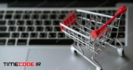دانلود عکس خرید اینترنتی Shopping Cart On Laptop