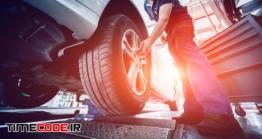 دانلود عکس مکانیک در حال تست ترمز ماشین در مکانیکی Automotive Suspension Test And Brake Test Rolls
