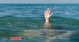 دانلود عکس مفهومی درخواست کمک Child Hand At Sea, Need For Help.